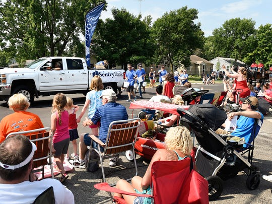 People line the streets for the Church of St. Joseph Parish Festival parade Tuesday, July 4, in St. Joseph.
