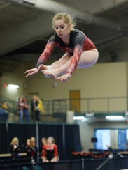 Katie Christopherson of Sisseton leaps while competing