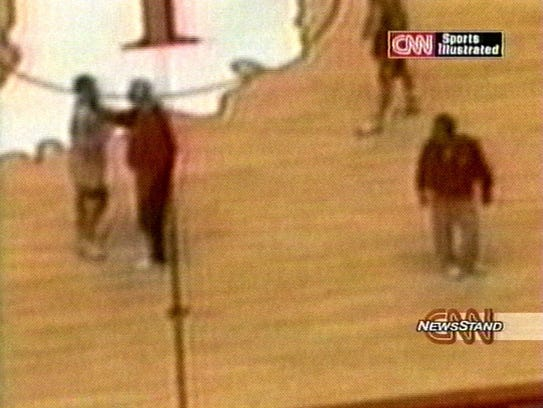 A capture from the footage CNN aired in 2000 documenting abuse by Bob Knight on his players. Here, he grabs the throat of Neil Reed.