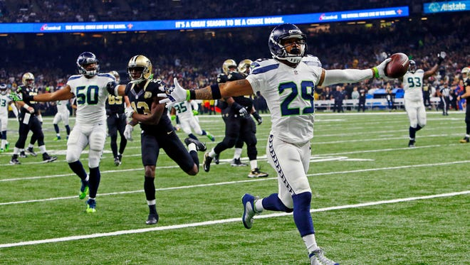 Seattle Seahawks free safety Earl Thomas (29) returns a fumble for a touchdown in the first half of an NFL football game against the New Orleans Saints in New Orleans, Sunday, Oct. 30, 2016.