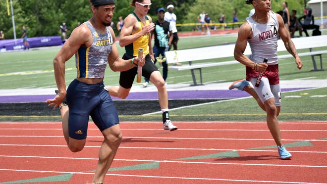 Battle's Trevonne Hicks, left, runs the last leg of the 4x100-meter relay at the MSHSAA Class 5 Sectional 3 track and field meet last year in O'Fallon.