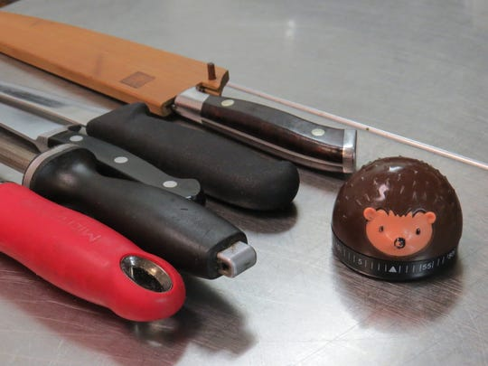 Tools of the trade: Tony Sewell keeps his knives, zester, sharpening steel and hedgehog kitchen timer close at hand in his work as executive chef for Main Course California, a catering company based in Ventura.