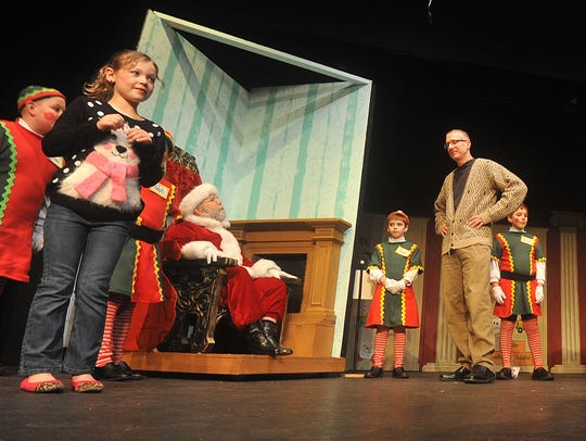 The cast of Miracle on 34th Street rehearse Tuesday