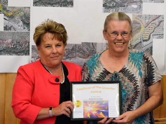 Denise Staab, right, received the community service quarterly employee award.