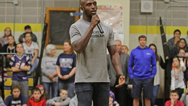 """The Patriots' Devin McCourty -- shown on a visit to Davisville Middle School in North Kingstown in 2018 -- says the team has had """"a bunch of good conversations over the last week"""" regarding the issues facing the country."""