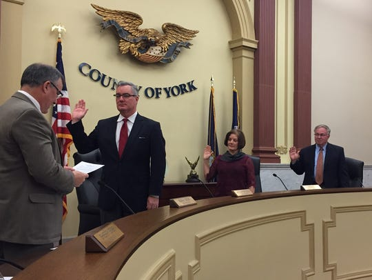In this 2016 file photo, York County Administrator Mark Derr swears in the York County commissioners, from left: Chris Reilly, Susan Byrnes and Doug Hoke.