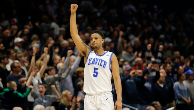 Xavier Musketeers guard Trevon Bluiett (5) raises his fist as time expires in overtime of the NCAA Big East Conference basketball game between the Xavier Musketeers and the Georgetown Hoyas at the Cintas Center in Cincinnati on Saturday, Feb. 3, 2018. The Musketeers secured a 96-91 win over the Hoyas in overtime.