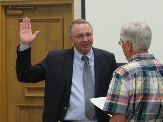 Dean Cox is sworn in as a member of the Washington County Commission by County Clerk Kim Hafen on Jan. 3, 2017.