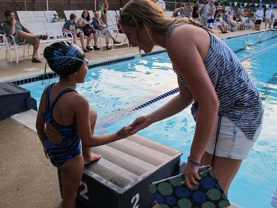 Laura Milowicki, once a Silverside swimmer, is now the team's assistant head coach.