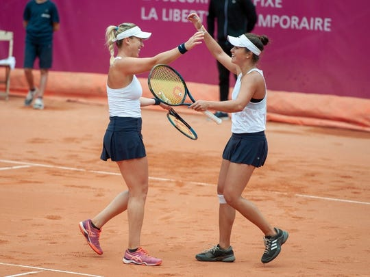 Desirae Krawczyk (right) celebrates her first WTA title with doubles partner Alex Guarachi in Gstaad, Switzerland on Sunday.