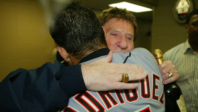 Tigers owner Mike Ilitch and Tigers catcher Ivan Rodriguez celebrate their clinching of a playoff spot after a win over the Royals in Kansas City on Sept. 24, 2006. The Tigers went on to win the A.L. pennant, but lost to the St. Louis Cardinals, 4-1, in the World Series.