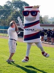 """Rockline's """"Captain Clean"""" gives a high five to Randy Schwoerer during the United Way kickoff Thursday September 17, 2015 at Wildwood Baseball Park in Sheboygan."""
