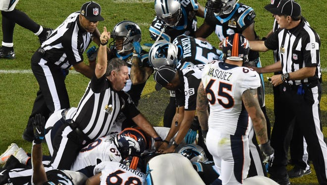 NFL umpire and Fort Myers resident Jeff Rice (44) signals a Carolina fumble recovery in Super Bowl 50 at Levi's Stadium.