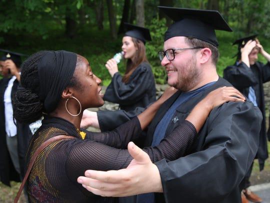 Bard College graduate Antonio Gansley-Ortiz, right,