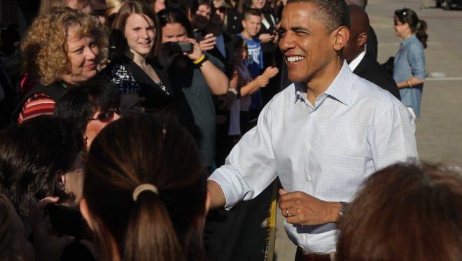 President Barack Obama greets spectators in downtown Decorah, Iowa, on Aug. 16, 2011.