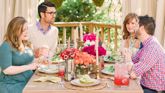 Designer Brian Patrick Flynn created a cozy, casual outdoor dining space for the 2014 HGTV.com Spring House with a pergola, which adds shade, as well as weather-resistant drapery that adds privacy.