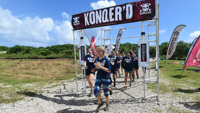 """Team """"We Paid for This ?!"""" finish their run in the KONQER Obstacle Course Race at the Jose and Herminia Memorial Off-Road Park in Yigo in this Nov. 29, 2015 file photo."""