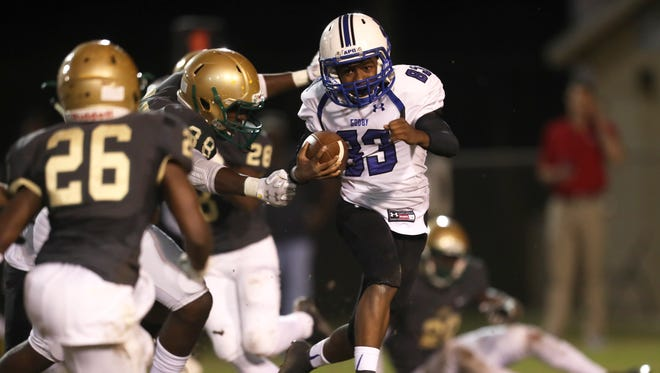 Godby's Alvin Jones III returns a kickoff against Lincoln during their game at Cox Stadium last year.