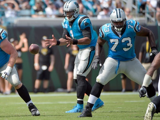 FILE - In this Sept. 13, 2015, file photo, Carolina Panthers offensivve tackle Michael Oher (73) block as quarterback Cam Newton (1) takes the snap during the second half of an NFL football game against the Jacksonville Jaguars in Jacksonville, Fla. The Panthers weren't planning to re-sign struggling left tackle Byron Bell last offseason, and Newton needed someone to protect his blindside. He thought Oher, the main character in the popular movie by that name, would be a perfect fit. (AP Photo/Phelan M. Ebenhack, File)