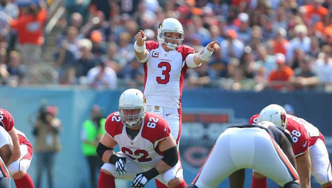 Sep 20, 2015: Arizona Cardinals quarterback Carson Palmer (3) calls a play during the first half against the Chicago Bears at Soldier Field.