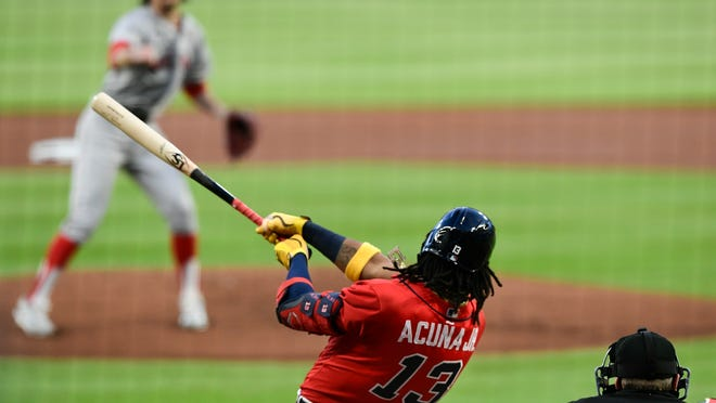 The Braves' Ronald Acuna Jr. powers a 495-foot home run, longest in the majors this season, off Red Sox starter Chris Mazza in the first inning in Atlanta.