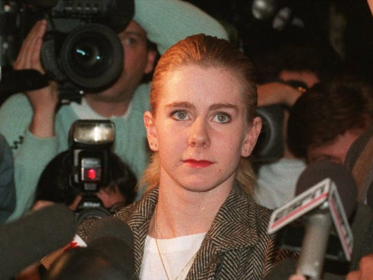 Tonya Harding faces the media, but didn't speak, after