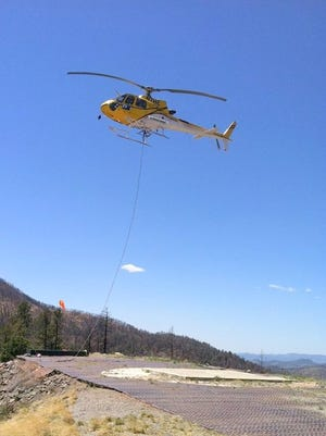 Helicopter longline training in Fort Bayard area.
