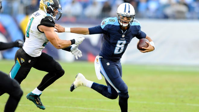 Dec 6, 2015; Nashville, TN, USA; Tennessee Titans quarterback Marcus Mariota (8) carrie the ball during the second half against the Jacksonville Jaguars at Nissan Stadium. The Titans won 42-39.  Mandatory Credit: Christopher Hanewinckel-USA TODAY Sports