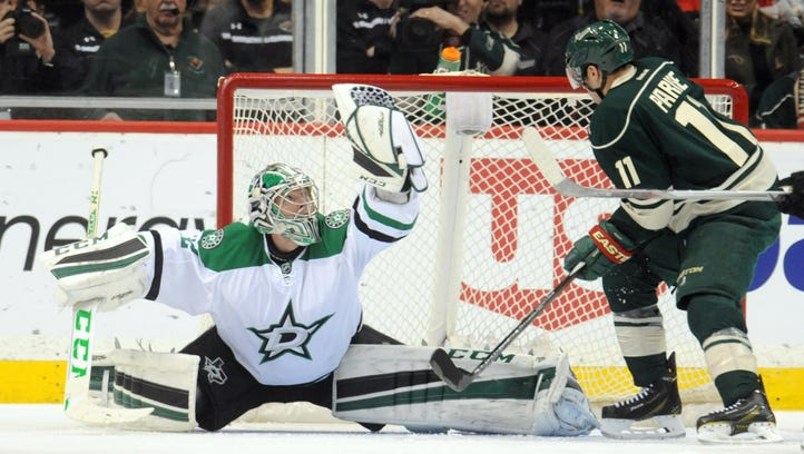 Dallas Stars goalie Kari Lehtonen (32) makes a save during the second period Tuesday against the Minnesota Wild at Xcel Energy Center in St. Paul. The Stars won 4-3 over the Wild in overtime.