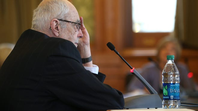 Iowa Department of Human Services Director Charles Palmer hears questions from Iowa legislators during a hearing on Thursday at the Iowa Capitol building in Des Moines. The department is looking into closing two mental health facilities.