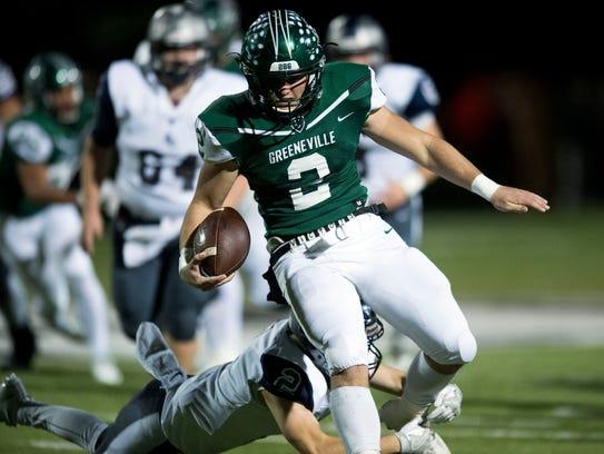 Greeneville quarterback Cade Ballard runs for yards