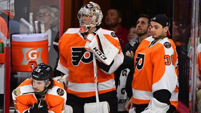 Goalies Steve Mason, left, and Michal Neuvirth both had poor seasons for the Flyers.