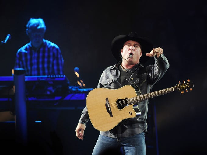 Garth Brooks is performing to a packed audience at
