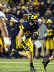 Michigan tight end Sean McKeon (84) rushes for a touchdown in the first quarter of an NCAA college football game against Minnesota in Ann Arbor, Mich., Saturday, Nov. 4, 2017. (AP Photo/Tony Ding)