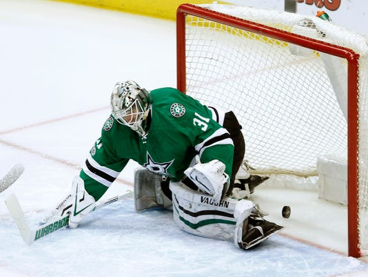 The puck slips by Dallas Stars goalie Antti Niemi and into the goal on a shot from Nashville Predators left wing Viktor Arvidsson during the first period of an NHL hockey game Thursday, April 6, 2017, in Dallas. (AP Photo/Tim Sharp)