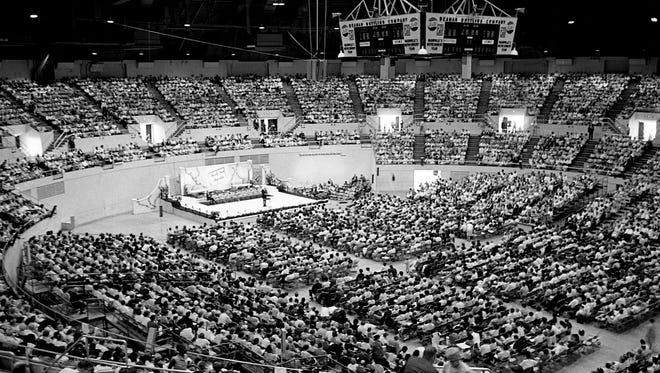 "In this file image, More than 10,000 Jehovah's Witnesses are jammed into Municipal Auditorium on Aug. 14, 1965, during the ""Word of Truth"" assembly."