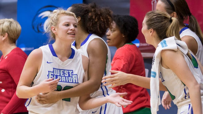 Halee Nieman (32) is congratulated by teammates after setting a new school record for most points in a game during the Montevallo vs UWF women's basketball game at the University of West Florida in Pensacola on Monday, December 18, 2017.