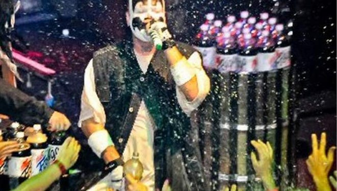 Insane Clown Posse members Shaggy 2 Dope, pictured here, and Violent J are expected to spray plenty of Faygo tonight at a Lansing concert venue.