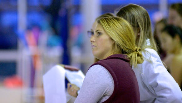 Ridgewood coach Kimberly Schmidt fields one of the