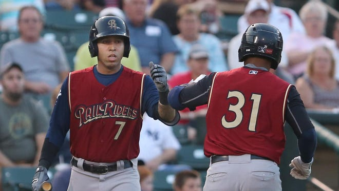 Scranton/Wilkes-Barre third baseman and Irondequoit native Cito Culver, left, high-fives teammate Gregorio Petit after Petit's solo home run in the second inning gave the Railriders a 1-0 lead over the Red Wings on Tuesday. The game was Culver's first playing at Frontier Field.