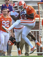 Clemson cornerback Trayvon Mullen (1) intercepts a ball intended for Clemson wide receiver Trevion Thompson (1) during the 3rd quarter of the spring game in Memorial Stadium in Clemson on Saturday, April 14, 2018.