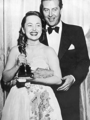 "Olivia de Havilland receives her Best Actress Oscar from actor Ray Milland for her performance in ""To Each his Own,"" directed by Mitchell Leisen, on March 19, 1947."