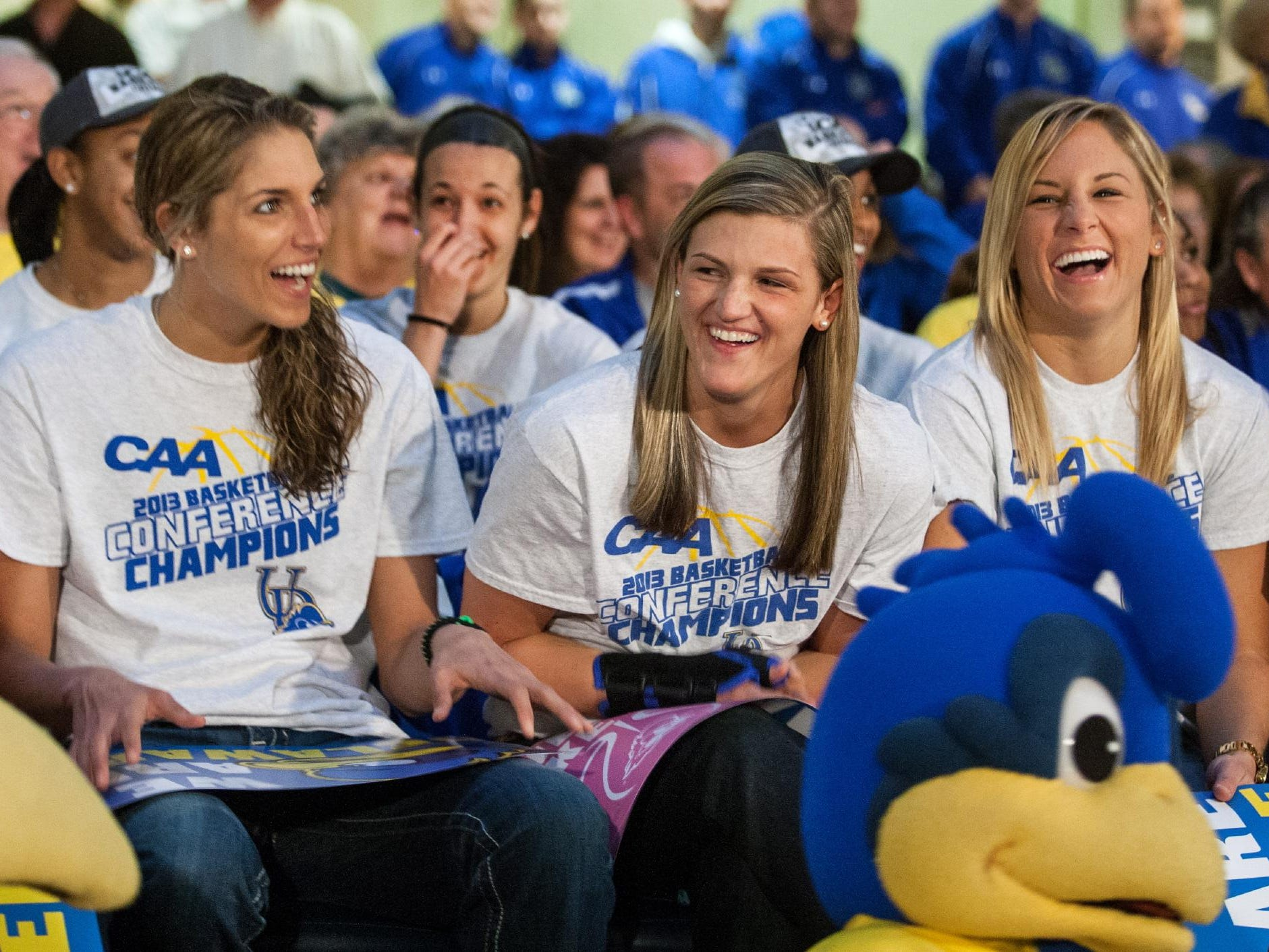 Delaware's Elena Delle Donne, left, and Lauren Carra, center, and Kayla Miller, right, share a laugh as they watch a season highlight video at an NCAA Tournament selection show party for the team at the Embassy Suites hotel in Newark, Del. on Monday evening, March 18, 2013.KYLE GRANTHAM/THE NEWS JOURNAL