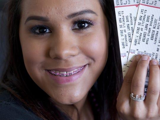 Larissa Mora, 18, holds tickets on Wednesday, March