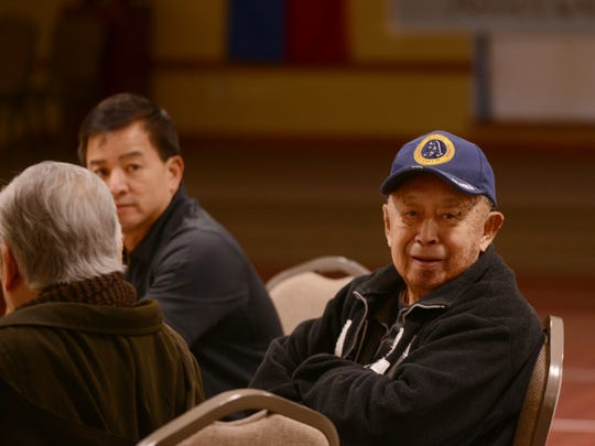 Dr. Conrado Sioson Sr. enjoys the West Tennessee Filipino-American Association annual Family Activity Night dinner fundraiser for Haiti missions Wednesday night at St. Mary's Catholic Church.