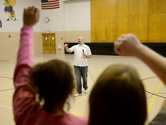 Former Spartan Anthony Ianni speaks to students at Concord Middle School February 4, 2015. Ianni, who has autism, speaks about overcoming the odds and bullying at his talks with schools.