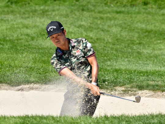 Aug 11, 2019; Jersey City, NJ, USA; Kevin Na hits out of a bunker on the 2nd hole during the final round of The Northern Trust golf tournament at Liberty National Golf Course. Mandatory Credit: Mark Konezny-USA TODAY Sports