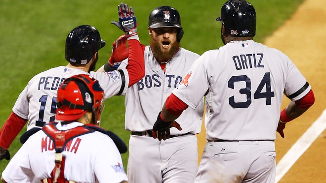 ST LOUIS, MO - OCTOBER 27:  Jonny Gomes #5 of the Boston Red Sox celebrates with teamates David Ortiz #34 and Dustin Pedroia #15 after hitting a three run home run to left field against Seth Maness #61 of the St. Louis Cardinals in the sixth inning during Game Four of the 2013 World Series at Busch Stadium on October 27, 2013 in St Louis, Missouri.  (Photo by Elsa/Getty Images)