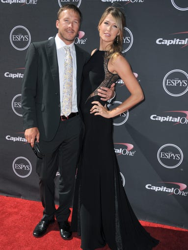 Skier Bode Miller, left, and Morgan Miller arrive at the ESPY Awards on Wednesday, July 17, 2013, at Nokia Theater in Los Angeles.