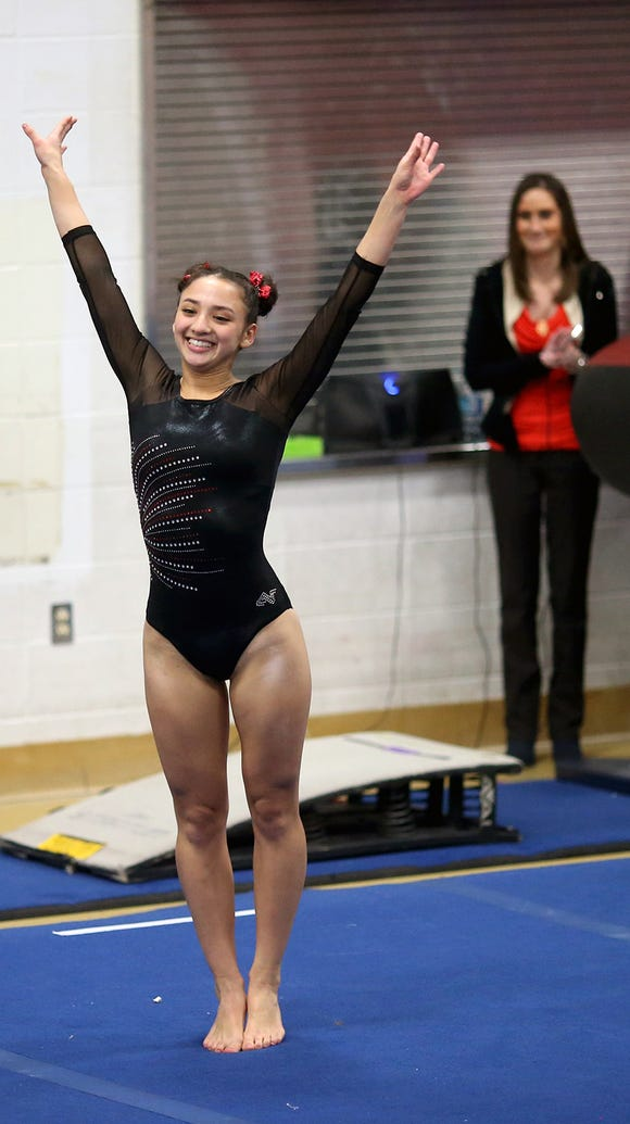 Kingston gymnastic Mikka Yamane and the Buccaneers begin competition at the state gymnastics championships on Thursday.